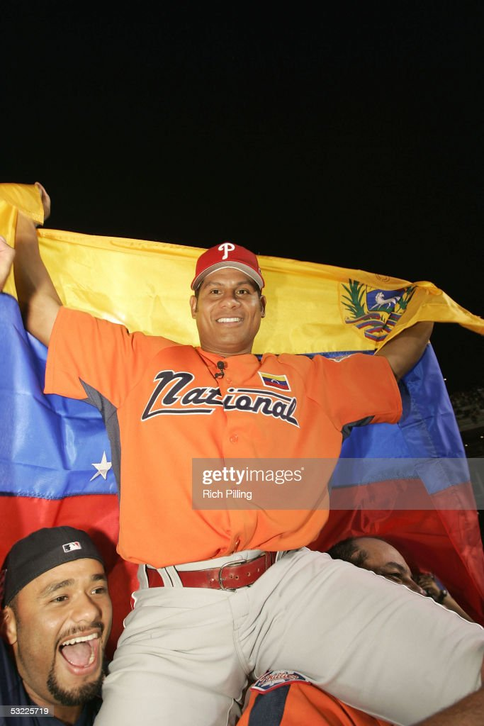 Philadelphia Phillie Bobby Abreu of Venezuela celebrates winning the 2005 Major League Baseball Home Run Derby with Johan Santana of the Minnesota Twins on July 11, 2005 at Comerica Park in Detroit, Michigan.