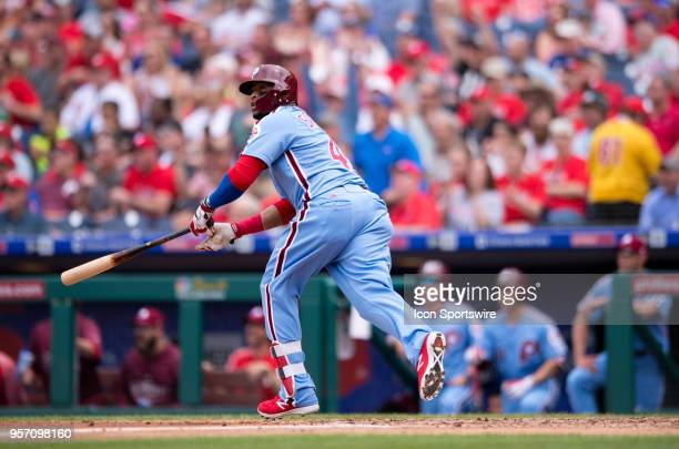 Philadelphia Phillies 1B Carlos Santana watches the ball after hitting a home run in the fourth inning during the game between the San Francisco...