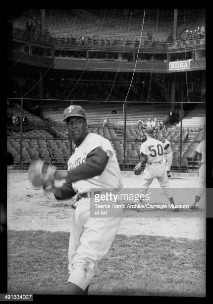 Philadelphia Phillies baseball player warming up at Forbes Field Pittsburgh Pennsylvania circa 19571962