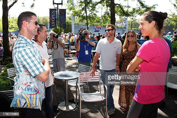 Philadelphia Phillies Baseball Players Kevin Frandsen John McDonald and Michael Young talk with Tennis player Ana Ivanovic of Serbia on Day Two of...