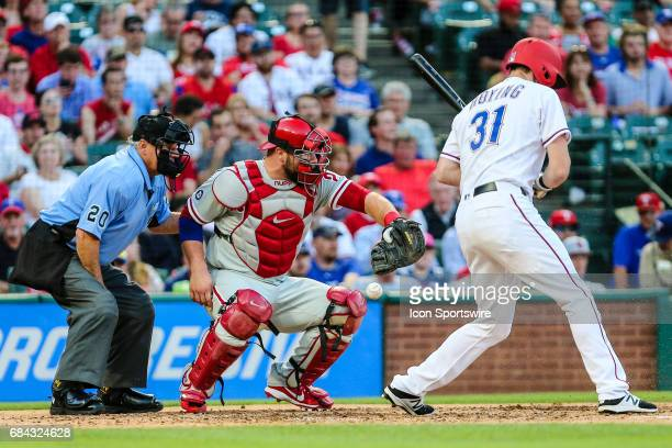 Philadelphia Phillies catcher Cameron Rupp bobbles a foul tip from Texas Rangers center fielder Jared Hoying during the game between the Texas...