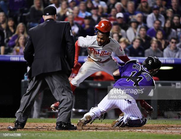 Philadelphia Phillies center fielder Roman Quinn tagged out at home by Colorado Rockies catcher Tony Wolters in the fourth inning at Coors Field...