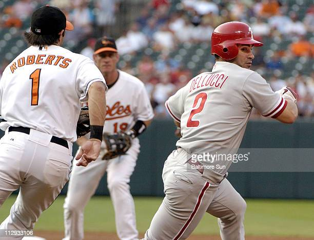 Philadelphia Phillies' David Dellucci right is tagged out on a rundown between first and second base by Baltimore Orioles' Brian Roberts left in the...