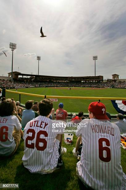 Philadelphia Phillies fans sit in the outfield while watching their team play the New York Yankees during a Spring Training game at Bright House...