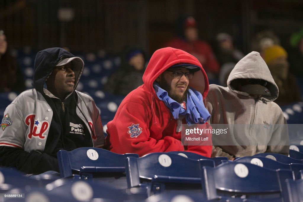 Philadelphia Phillies fans try to keep warm during the game against the Pittsburgh Pirates at Citizens Bank Park on April 19, 2018 in Philadelphia, Pennsylvania. The Phillies defeated the Pirates 7-0.