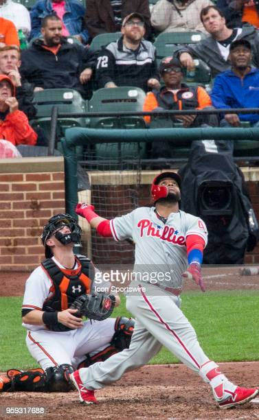 Philadelphia Phillies first baseman Carlos Santana and Baltimore Orioles catcher Chance Sisco look up for the ball during a MLB game between the...