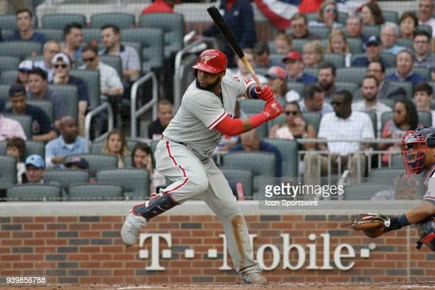 Philadelphia Phillies First baseman Carlos Santana bats during the 2018 Opening Day game between the Atlanta Braves and the Philadelphia Phillies on...