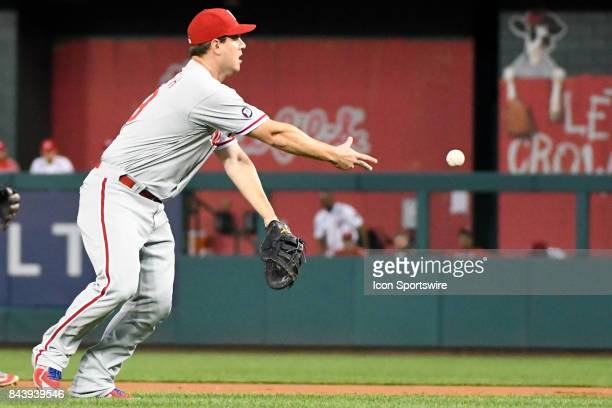 Philadelphia Phillies first baseman Tommy Joseph makes a late toss to first base on an infield single during an MLB game between the Philadelphia...