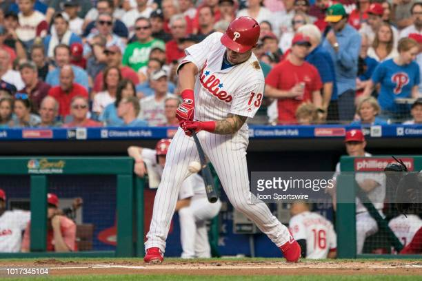 Philadelphia Phillies Infield Asdrubal Cabrera hits a single during the first inning of a MLB game between the Boston Red Sox and the Philadelphia...
