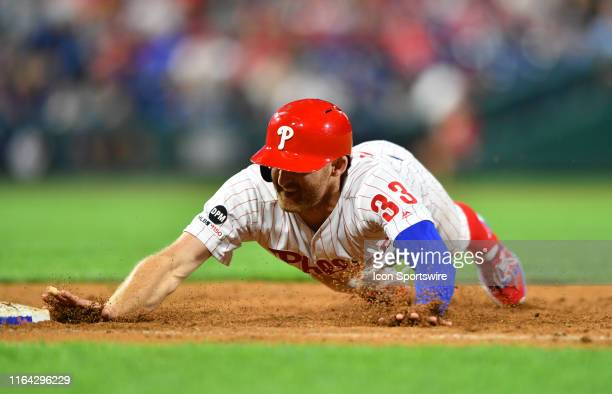 Philadelphia Phillies Infield Brad Miller dives back to first in the ninth inning during the game between the Pittsburgh Pirates and Philadelphia...