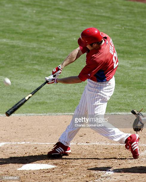Philadelphia Phillies infielder Chase Utley makes contact with the ball in a spring training game versus the N.Y. Yankees on March 4, 2007 at Bright...