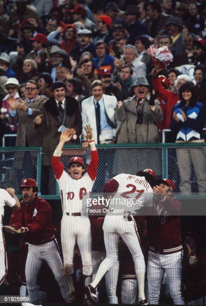 Philadelphia Phillies' infielder Larry Bowa jumps for joy as outfielder Bake McBride walks to the dugout after hitting a home run during game 1 of...
