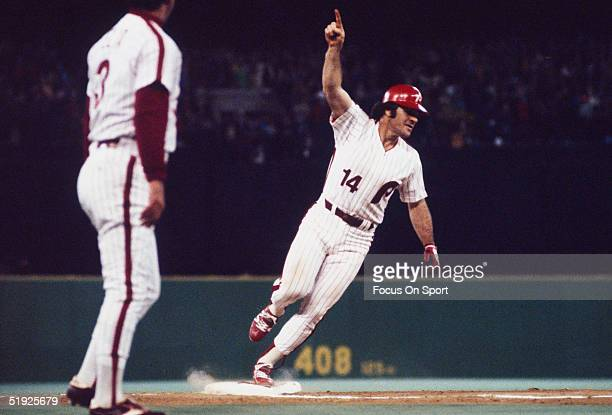 Philadelphia Phillies' infielder Pete Rose gestures to the crowd and runs the bases during the World Series against the Kansas City Royals at...