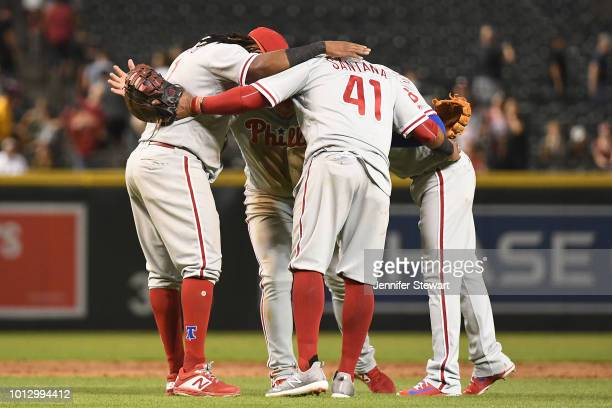 Philadelphia Phillies infielders Maikel Franco Carlos Santana Asdrubal Cabrera and Cesar Hernandez celebrate after the MLB game against the Arizona...
