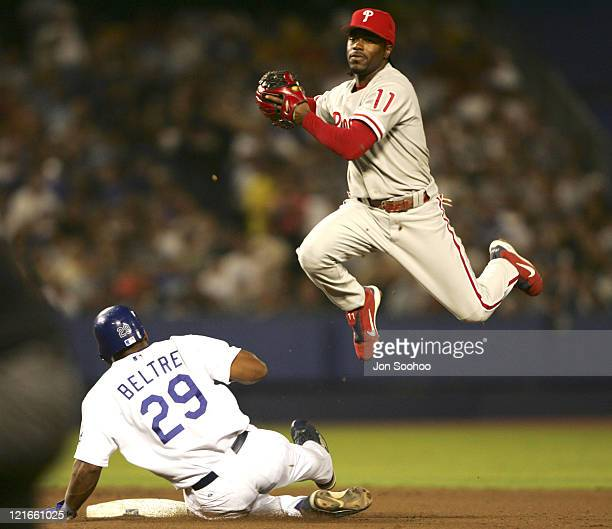 Philadelphia Phillies Jimmy Rollins can't turn to as Los Angeles Dodgers Adrian Beltre slides into second at Dodger Stadium