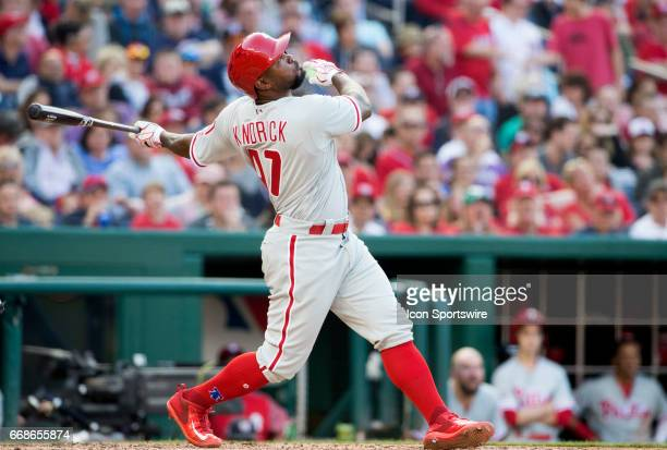 Philadelphia Phillies left fielder Howie Kendrick tracks the trajectory of his hit during a MLB game between the Washington Nationals and the...