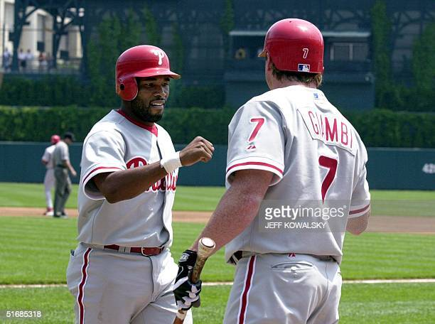 Philadelphia Phillies' Marion Anderson is cvongratulated by his teammate Jeremy Giambi after scoring in the first inning at Comerica Park in Detroit...