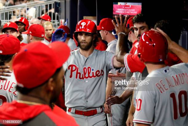 Philadelphia Phillies Outfield Bryce Harper is greeted by his teammates after hitting a home run during the MLB game between the Atlanta Braves and...
