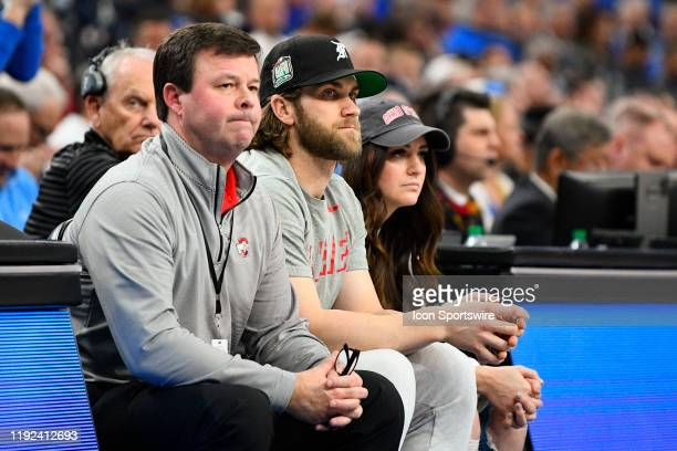 Philadelphia Phillies outfielder Bryce Harper and his wife Kayla Varner look on during the CBS Sports Classic between the Ohio State Buckeyes and the...