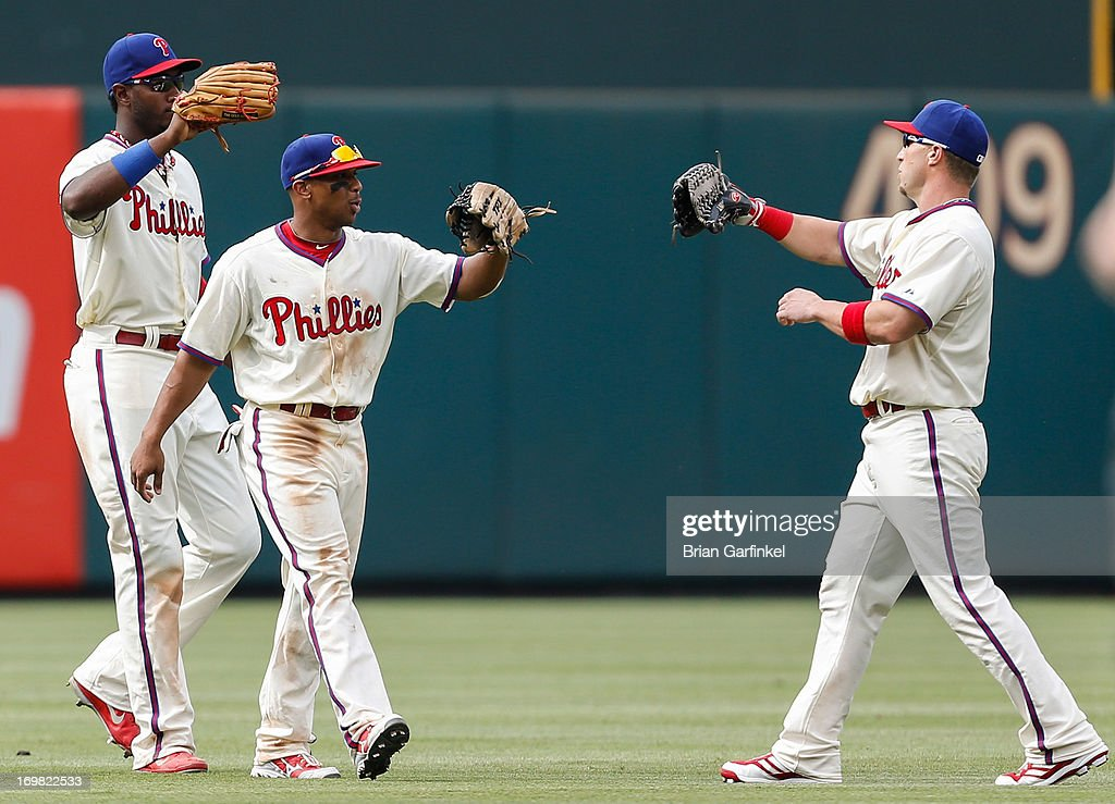 Philadelphia Phillies outfielders Domonic Brown #9, Ben Revere #2. and Laynce Nix #19 congratulate each other after the game against the Milwaukee Brewers at Citizens Bank Park on June 2, 2013 in Philadelphia, Pennsylvania. The Phillies won 7-5.
