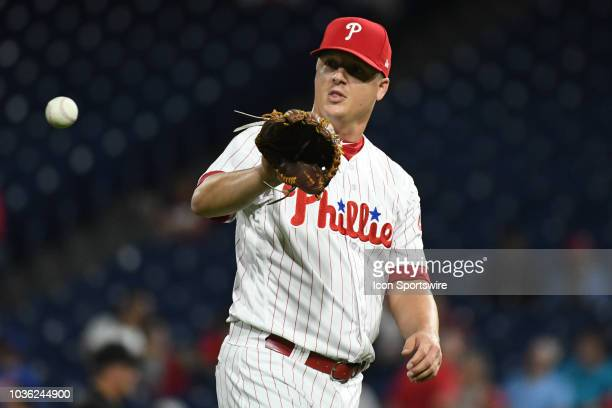 Philadelphia Phillies Pitcher Aaron Loup catches the ball during the MLB game between the New York Mets and the Philadelphia Phillies on September 19...