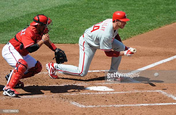 Philadelphia Phillies pitcher Roy Halladay lays down a sacrifice bunt in the third inning against the Washington Nationals at Nationals Park in...