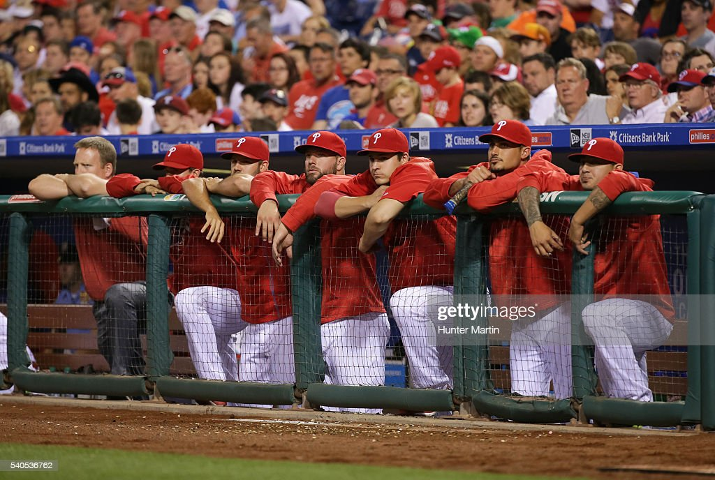 Philadelphia Phillies players stand in the dugout as they watch in the seventh inning during a game against the Toronto Blue Jays at Citizens Bank Park on June 15, 2016 in Philadelphia, Pennsylvania. The Blue Jays won 7-2.