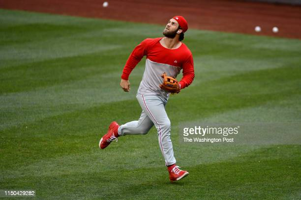 Philadelphia Phillies right fielder Bryce Harper shags balls in the outfield during batting practice prior to the game at Nationals Park June 17 2019...