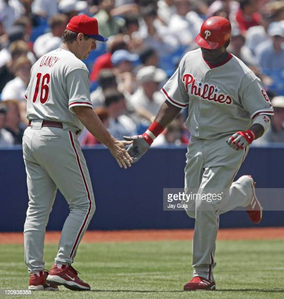 Philadelphia Phillies Ryan Howard is congratulated by 3rd base coach Bill Dancy after hitting a HR during today's game vs the Toronto Blue Jays at...