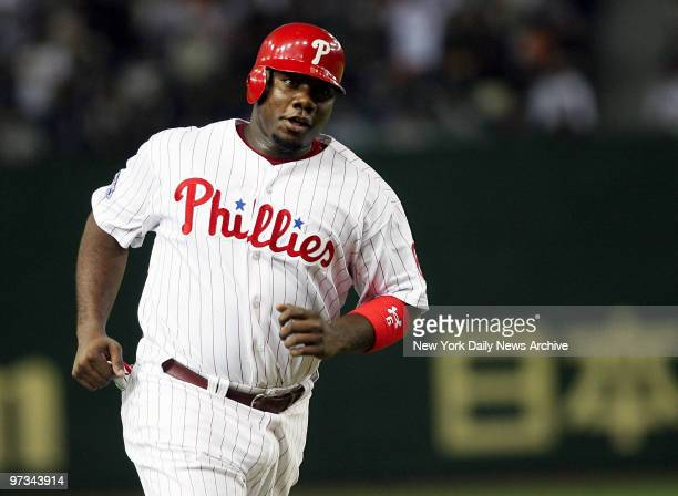 Philadelphia Phillies' Ryan Howard rounds third on Minnesota Twins' Joe Mauer's two-run homer in the fifth inning of Game 2 of the 2006 Japan...