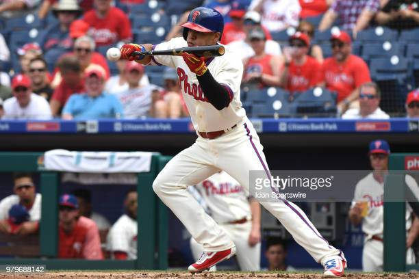 Philadelphia Phillies Second base Cesar Hernandez attempts a bunt during a Major League Baseball game between the St Louis Cardinals and the...