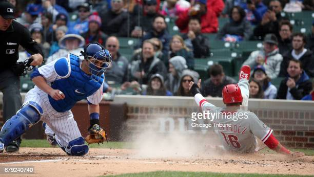 Philadelphia Phillies second baseman Cesar Hernandez scores behind Chicago Cubs catcher Miguel Montero in the third inning on Thursday May 4 2017 at...