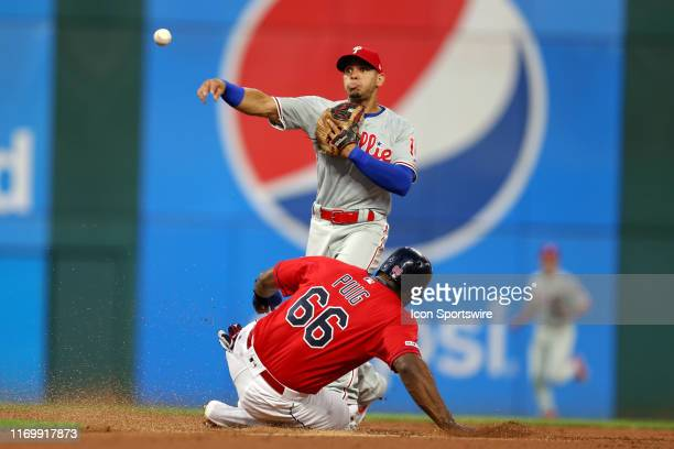 Philadelphia Phillies second baseman Cesar Hernandez throws to first base after forcing out Cleveland Indians right fielder Yasiel Puig at second...