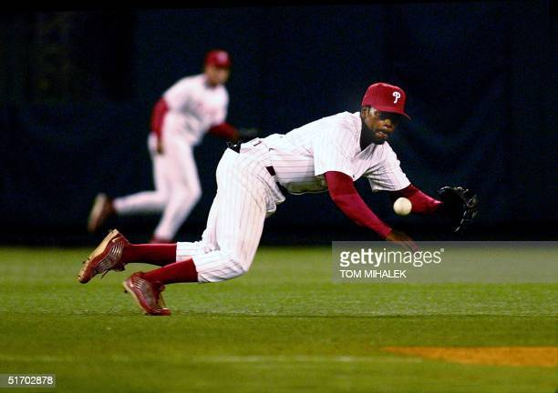Philadelphia Phillies shortstop Jimmy Rollins dives towards a line drive hit by Atlanta Braves Vinny Castilla in the sixth inning of their game 08...