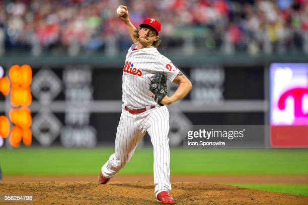 Philadelphia Phillies starting pitcher Aaron Nola winds up to pitch during the MLB game between the San Francisco Giants and the Philadelphia...