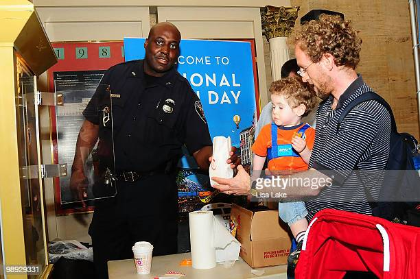 Philadelphia Police officer hands out popcorn at the Amtrak National Train Day Celebration 2010 Philadelphia at 30th Street Station on May 8 2010 in...