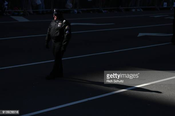 Philadelphia police officer patrols in front of City Hall during the team's Super Bowl Victory Parade on February 8 2018 in Philadelphia Pennsylvania