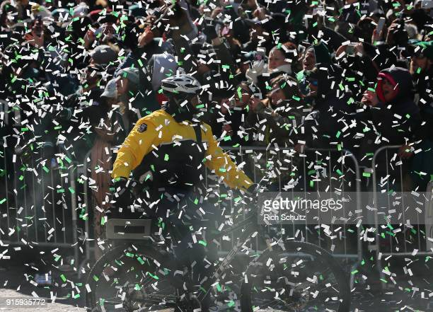Philadelphia Police officer rides his bike as confetti falls during the Philadelphia Eagles Super Bowl Victory Parade on February 8 2018 in...