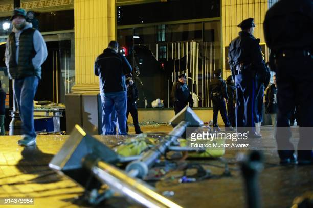 philadelphia police officers try to keep fans away after broken macy's store windows while celebrating the Philadelphia Eagles' victory in Super Bowl...