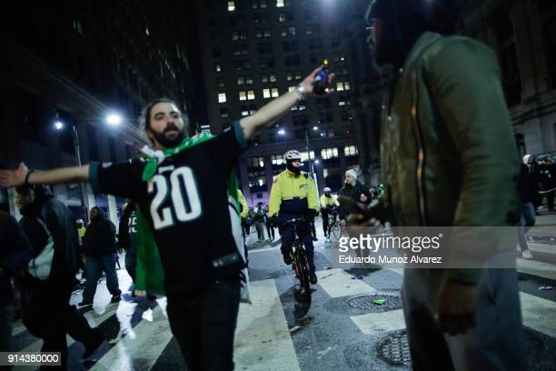 Philadelphia police officers try to keep fans away from City Hall while celebrating the Philadelphia Eagles' victory in Super Bowl LII game against...