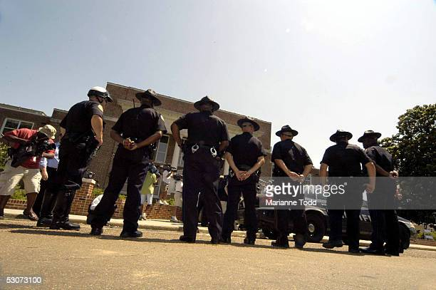 PHILADELPHIA MS Philadelphia police stand guard outside the Neshoba County Courthouse during the trial of Edgar Ray Killen on June 15 2005 in...