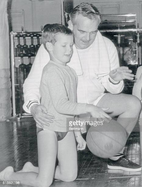 Prince Rainier of Monaco and his son Prince Albert bounce a basketball during a workout at the Philadelphia Athletic Club The Royal family was in...