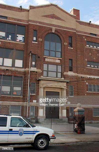 Philadelphia School District Police Officer sits in his patrol car in front of Peirce Elemantary School February 17 2004 in Philadelphia Pennsylvania...