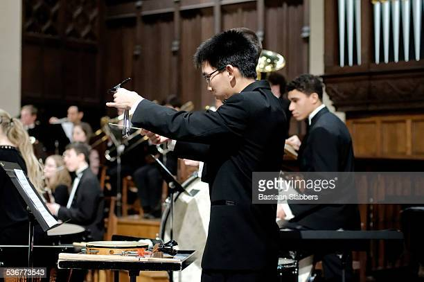 philadelphia sinfonia youth orchestra plays for packed church - triangle percussion instrument stock photos and pictures