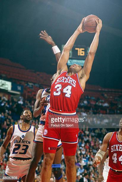 Philadelphia Sixers' forward Charles Barkley jumps and grabbs the rebound against the Washington Bullets during a game at Capital Center circa 1990...