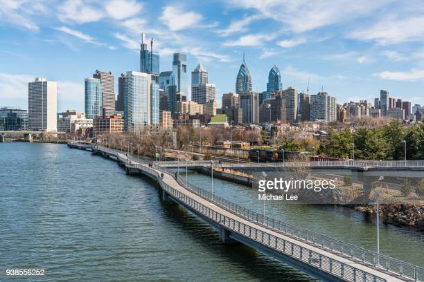 philadelphia skyline view from south street bridge - university of pennsylvania stock photos and pictures