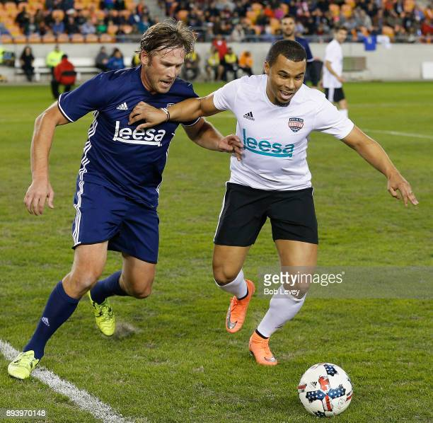 Philadelphia Union forward Charlie Davies holds off Olympic skier Bode Miller during the Kick In For Houston Charity Soccer Match at BBVA Compass...