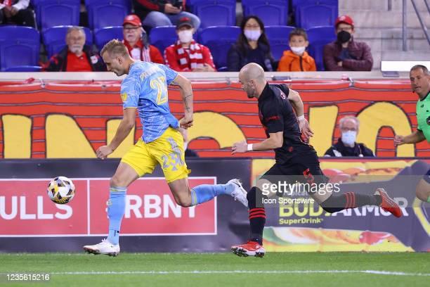 Philadelphia Union forward Kacper Przybylko and New York Red Bulls defender Andrew Gutman during the Major League Soccer game between the New York...