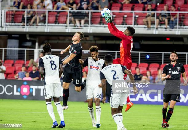 Philadelphia Union goalkeeper Andre Blake saves a header from DC United defender Frederic Brillant during a MLS match between DC United and the...