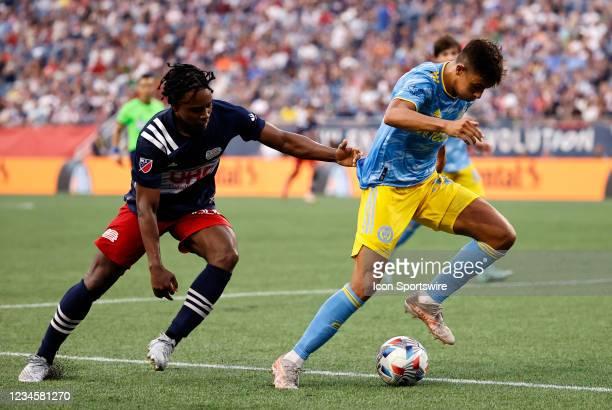 Philadelphia Union midfielder Quinn Sullivan slips past New England Revolution midfielder DeJuan Jones during a match between the New England...